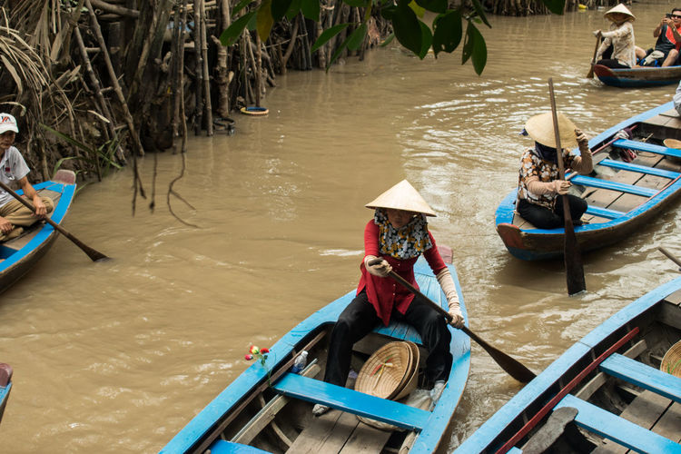 Mekong Delta Mekong River Vietnam Day High Angle View Men Mode Of Transport Moored Nature Nautical Vessel Occupation One Person Outdoors People Real People Sitting Transportation Water