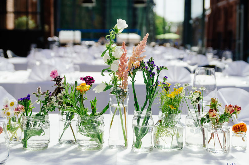 Various Flower Vases On Table At Restaurant