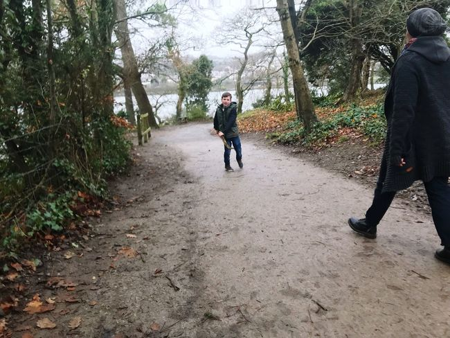Winter stroll Stroll Along The River Two People Walking Rear View Real People Tree Day Boys The Way Forward Full Length Childhood Nature Outdoors Togetherness Lifestyles Warm Clothing