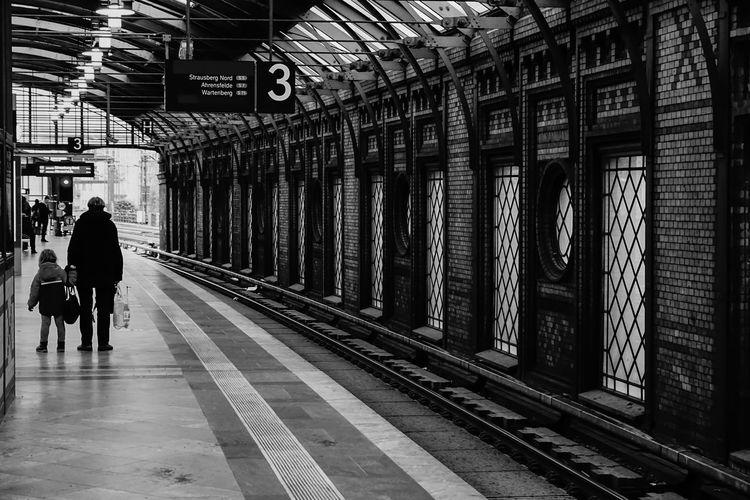 People walking at railroad station platform
