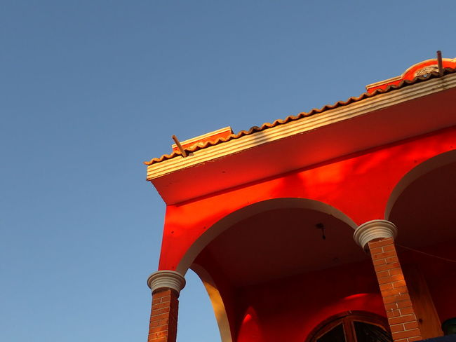 EyeEm Selects Red Low Angle View Arch Architecture History Travel Destinations Day No People Outdoors Sky Close-up Roof New On Eyeem Cut Out Red Sunrise Lighting Simple Photography Colorful