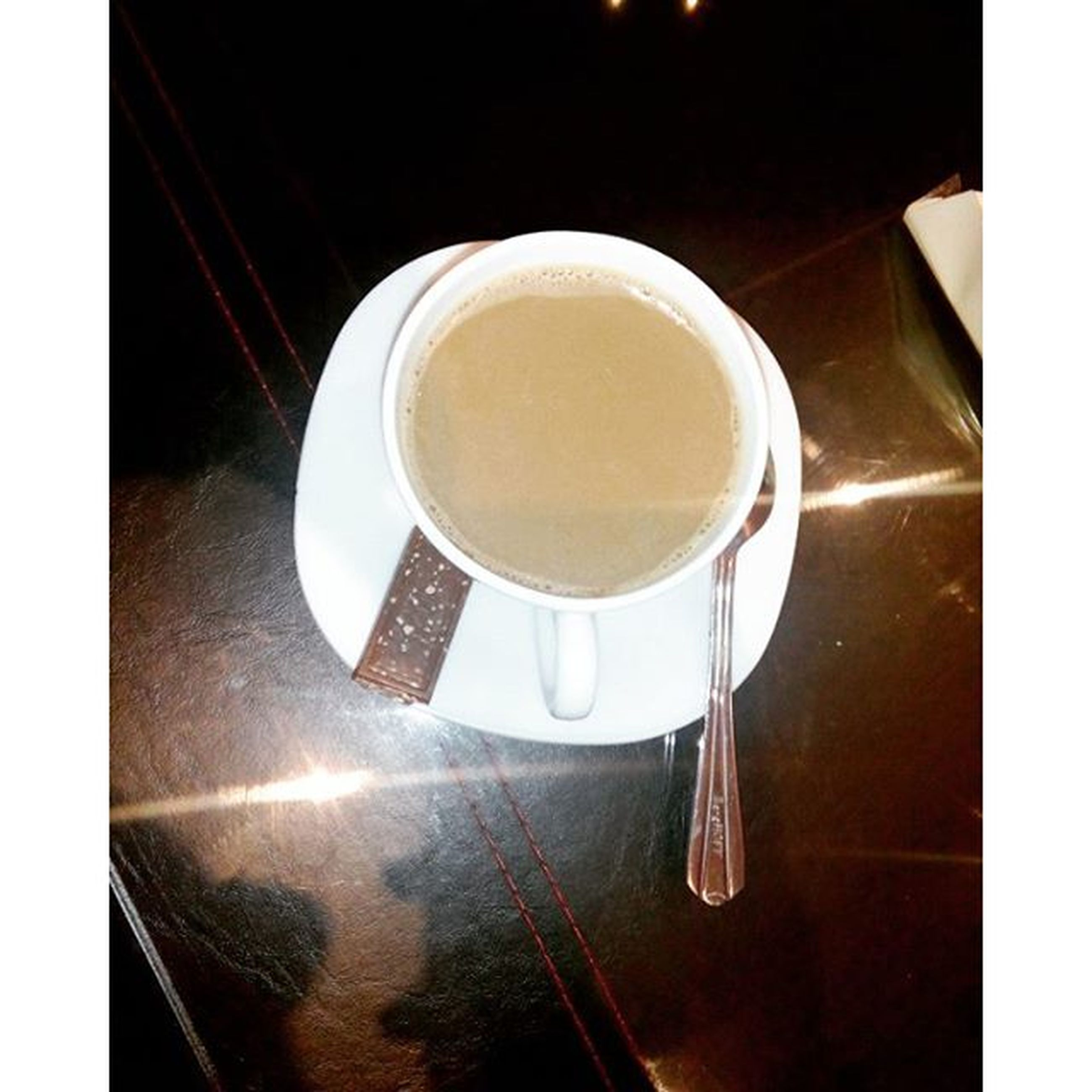 indoors, drink, transfer print, food and drink, coffee cup, refreshment, table, coffee - drink, auto post production filter, still life, saucer, coffee, spoon, cup, high angle view, close-up, freshness, no people, directly above, tea cup