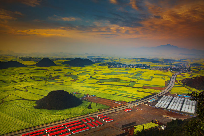 Agriculture Beauty In Nature Cloud - Sky Day Landscape Mountain Nature No People Outdoors Patchwork Landscape Raprseed Road Rural Scene Scenics Sky Sunrise Sunset Tranquil Scene Tranquility Transportation Travel Destinations Tree