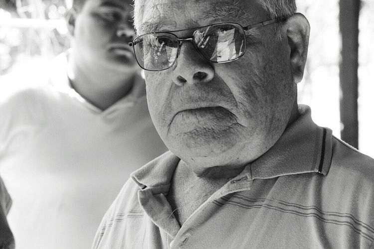 My Favorite Photo This man is not my father but at the same time he is! He raised me, took care of me and most importantly, set an example. He's been a positive influence in my short lived life. This shot was taken after I went to visit him this February, 2016 in Jalisco, Mexico in his home. We were all saying our goodbyes to each other after a weekend family get-together which I made the trip from LA. I was taking photos of this sad moment for us all, when he turned to me and I was able to capture this touching image. Life Portraits