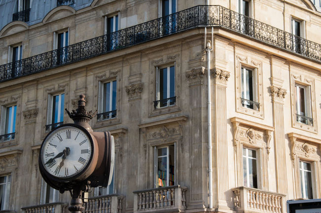 Composition of the Clock near Notre Dame and typical Parisian facade Paris Architecture Building Exterior Built Structure City Clock Clock Face Day Hour Hand Low Angle View Minute Hand No People Outdoors Roman Numeral Time Window
