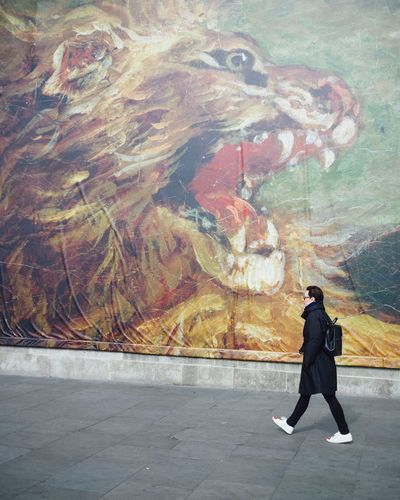 Trafalgar Square London colour street Trafalgar Square lion Billboard Delacroix exhibition Up Close Street Photography