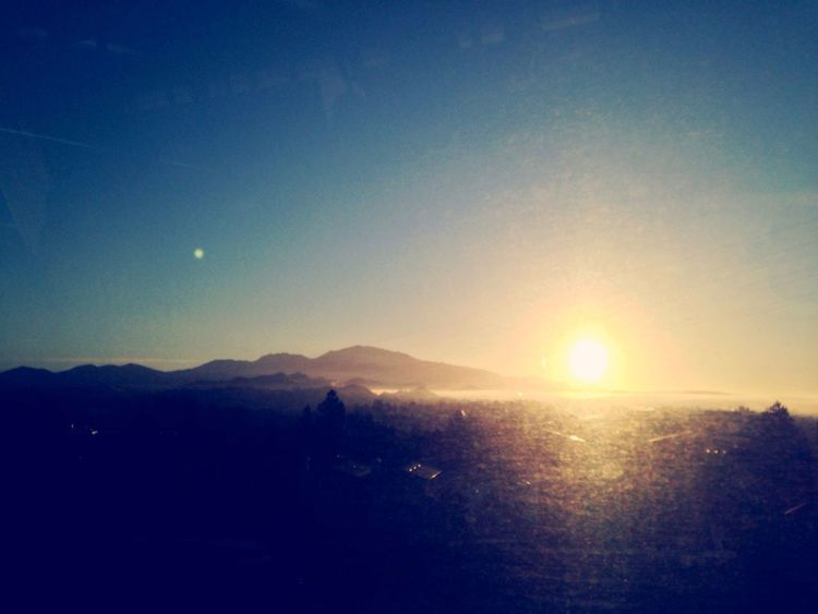 Fall: crisp brisk blue cold sky. Mt diablo always to my south east. Clouds low lying this morning creepin through the valley to be burned off by midday Sun Landscape Sunset Silhouette Nature Sunlight No People Scenics Beauty In Nature Outdoors Sky Mtdiablo, Ca ViewfromBART