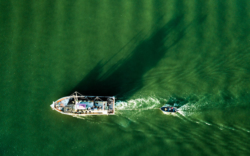 Directly above view of boat sailing in sea