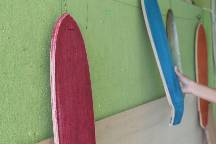 View of skateboards hanging in workshop
