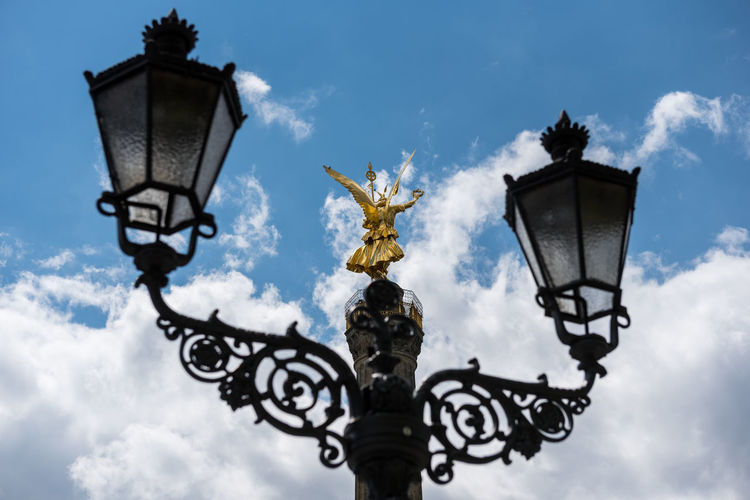 Low Angle View Of Street Light And Berlin Victory Column Against Sky