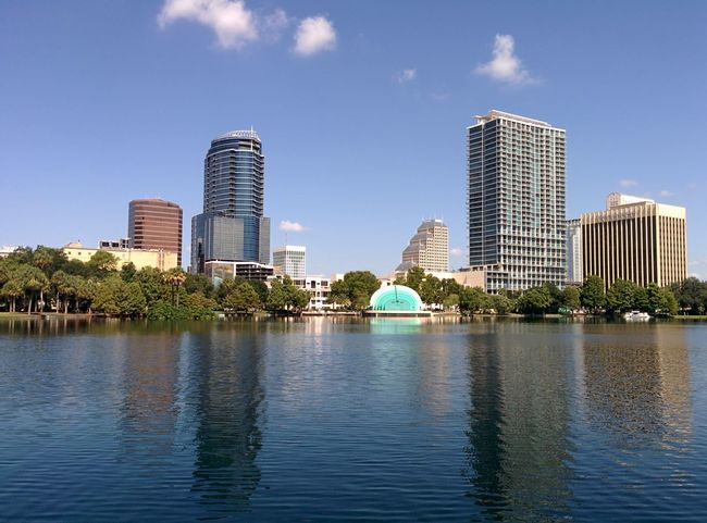 The City Beautiful Orlando Florida Downtown Park Lake Lake Eola Park Water City Life City View  Hanging Out Taking Photos Relaxing Sky The City Beautiful Blue Sky Scenics