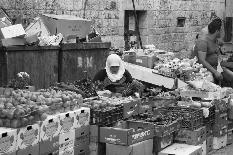 EyeEm Market SUK Walking Around Working Blak And White Canon Canon Photography Canon_photos Day Eye4photography  Food Occupation Orientalmarket Real People Stolenshot Streetphoto_bw Streetphotography Vegetables Wall - Building Feature Women
