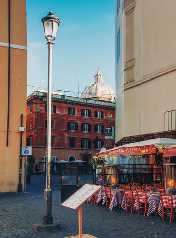 Building Exterior Architecture Built Structure Building City Street Day Nature Sky Street Light Window Clear Sky Seat Lighting Equipment Outdoors Residential District No People Cafe Chair Sidewalk Cafe Rome Church Italy Cityscape EyeEmNewHere