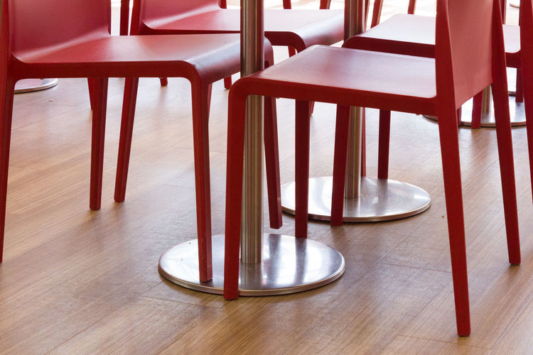 Absence Business Cafe Chair Day Empty Flooring Furniture Hardwood Floor Indoors  Metal No People Red Restaurant Seat Setting Still Life Table Wood Wood - Material