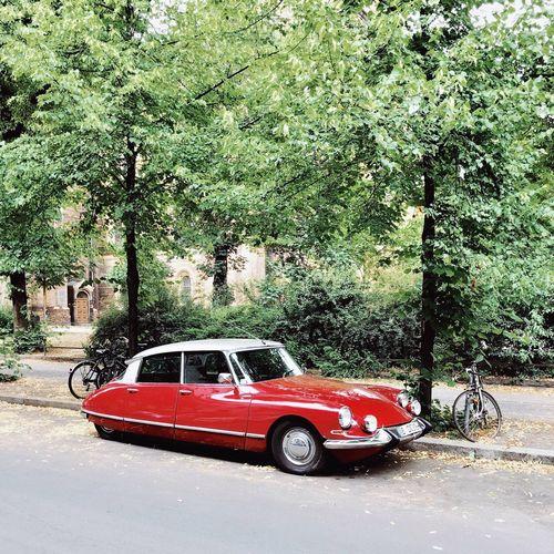 Red vintage car on street in city