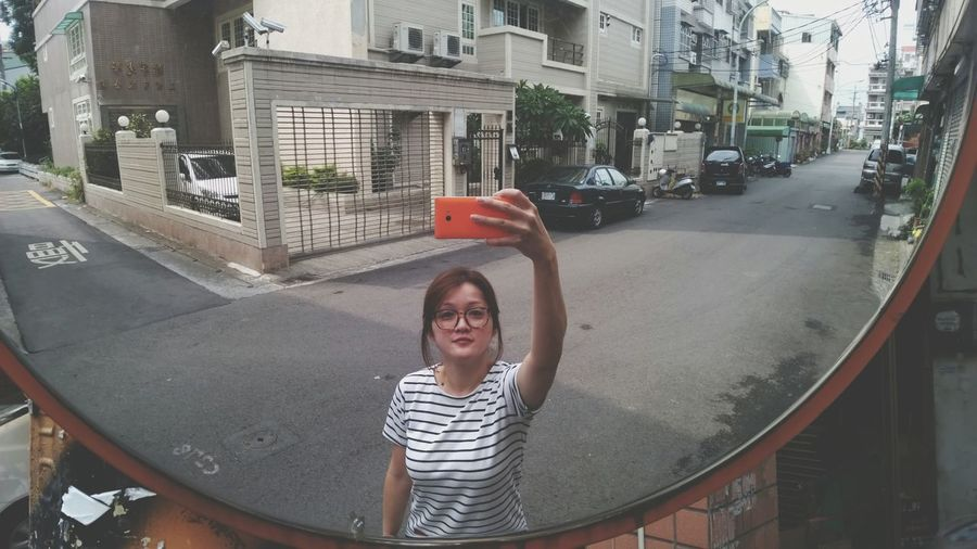 Woman taking a picture of herself with a mobile phone