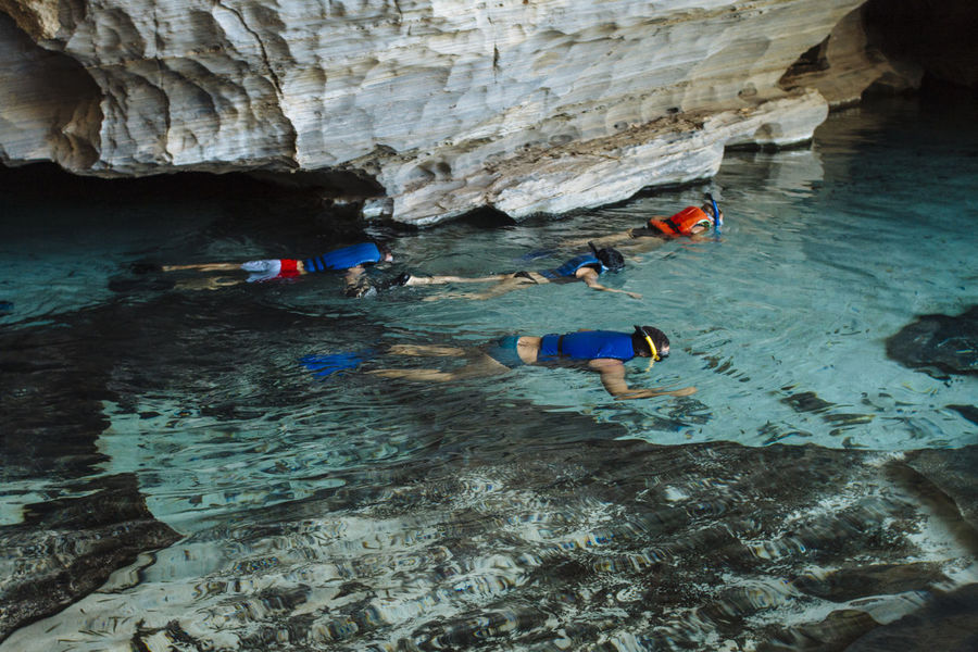 group of friends practicing snorkeling observes the fish in the grotto of Pratinha, Chapada Diamantina Having Fun Lifestyle Snorkeling Swimming Adventure Cave Caves Joy Life Jacket Lifestyles Nature Snorkel Travel Destinations Connected By Travel Done That. Lost In The Landscape