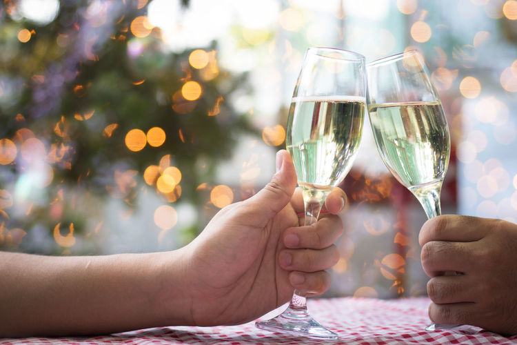 Alcohol Bonding Celebration Celebratory Toast Couple - Relationship Drink Focus On Foreground Food And Drink Glass Hand Holding Human Body Part Human Hand Men Positive Emotion Real People Refreshment Togetherness Two People Wine Wineglass Women