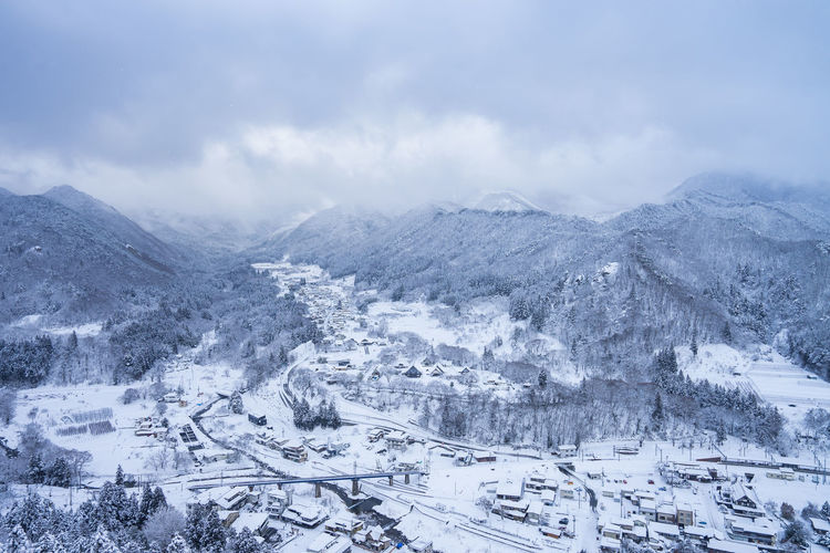 Snow Winter Cold Temperature Scenics - Nature Environment Landscape Mountain Nature Cloud - Sky Beauty In Nature Sky City Architecture No People Day Transportation Built Structure Building Exterior Mountain Range Outdoors Snowcapped Mountain Snowing Ski Resort