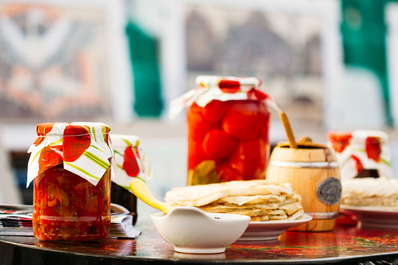Marinated tomatoes, pancakes and honey pot. Traditional snacks Belarus Belarus Food And Drink National Snack Tradition Close-up Culture Folk Food Food And Drink Holyday Honey Maslenitsa No People Pankakes Pickles Ready-to-eat Russian Sauce Seaming Shrovetide Table Testy Tomato Traditional