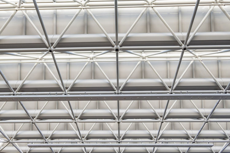 Low angle view of seamless metal structure ceiling of narita airport.