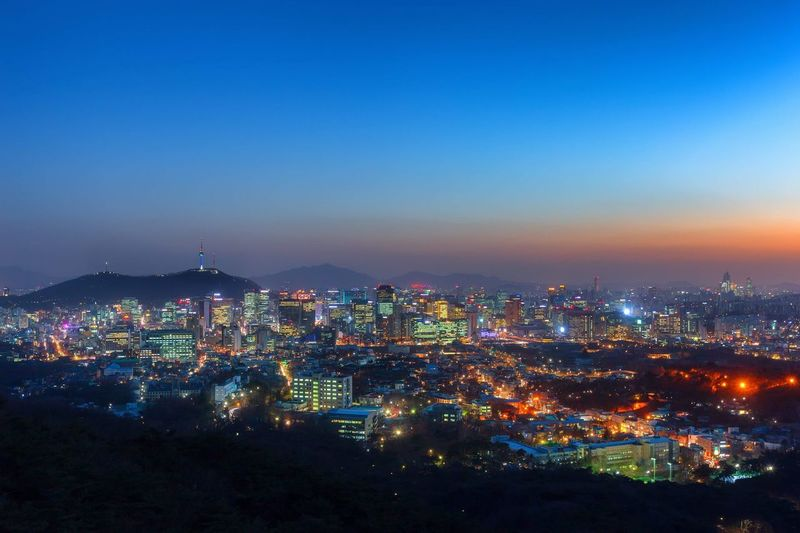 Sunset and viewpoint of Seoul downtown Sunset Twilight National Park Landmark Seoul Tower Namsan Urban Mountain Seoul Korea Cityscape Building Exterior Architecture Built Structure City Illuminated Sky Cityscape Building Nature No People Night Blue Skyscraper Light Outdoors