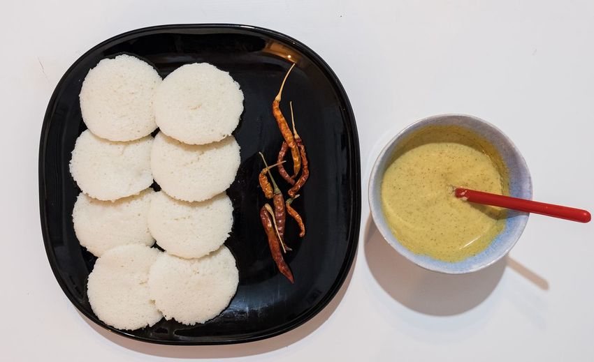 Idli is a powerhorse in south indian cuisine. Its hard to miss it when travelling in south india Food And Drink Food Freshness Bowl Kitchen Utensil Table Breakfast Temptation Still Life White Background Indian Vegetarian Food Idli Chutney South Indian Food Tasty Dishes Yummy EyeEmNewHere EyeEm Best Shots EyeEm Selects Chilli