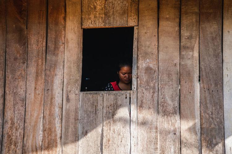 Portrait of boy in window