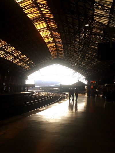 Station Railway Victorian Architecture Engineering People Distant Figures People Talking Group Of People Sunlight Light Light And Shadow Liminal Space Journey Intricate Immensity Architecture Station Platform Station Architecture Train Tracks Sillouette Sillhouette Railway Tracks