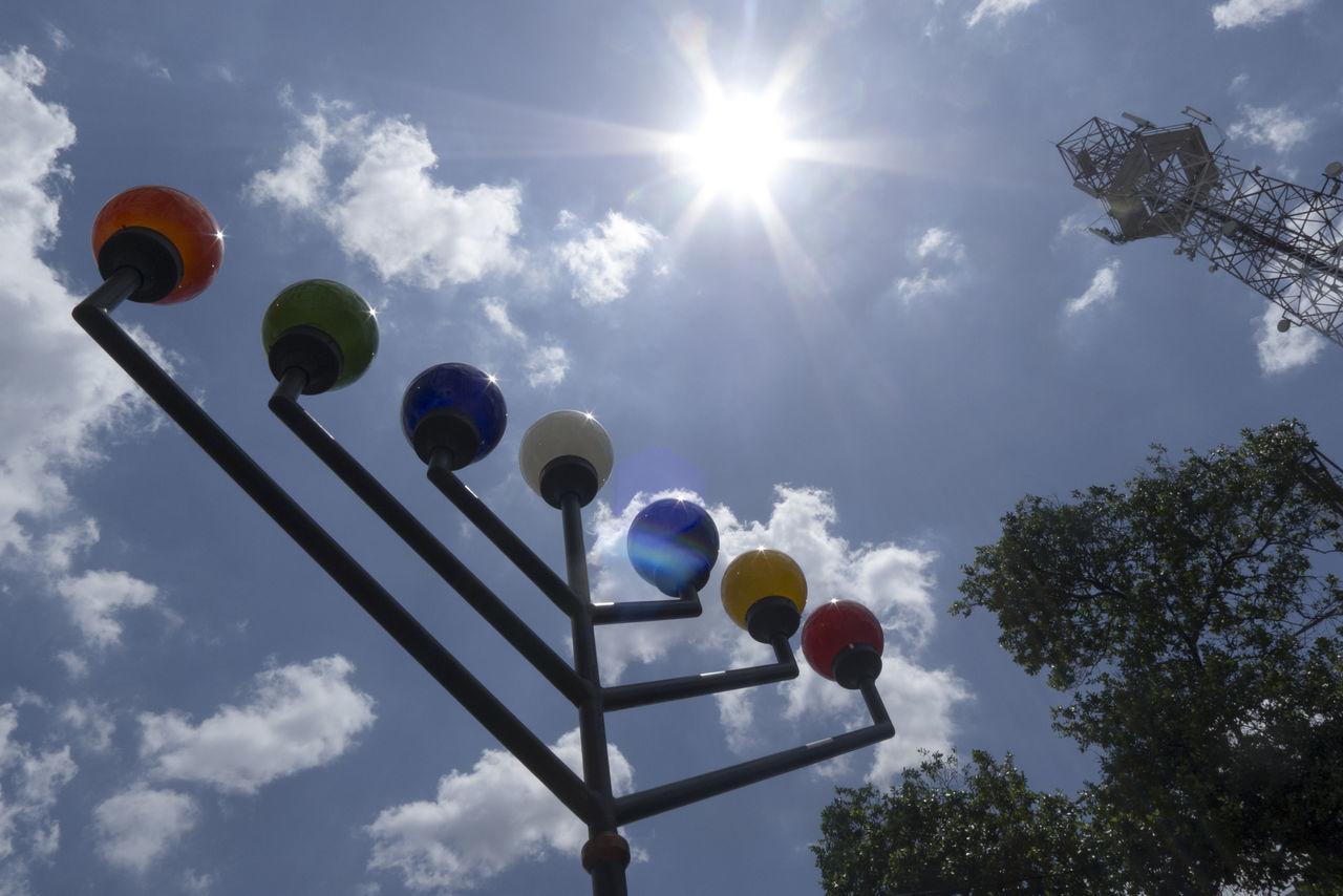 sunlight, low angle view, cloud - sky, sky, sunbeam, sun, day, balloon, lens flare, outdoors, no people, helium balloon, tree
