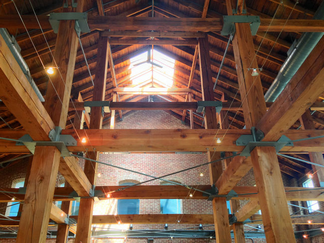 Big wooden beams to a man made structure. Architectural Column Architecture Built Structure Ceiling Deterioration Factory Glowing Illuminated Interior Lighting Equipment Low Angle View Night No People Wood - Material