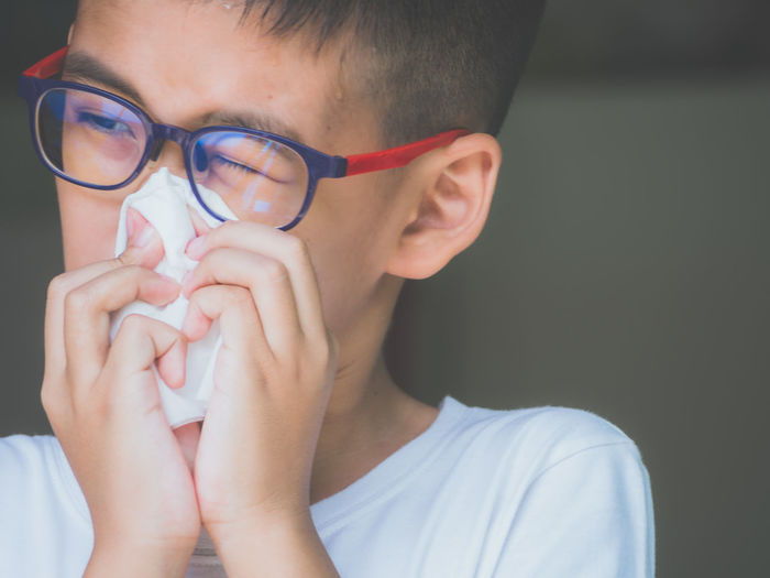 Close-up portrait of boy wearing eyeglasses