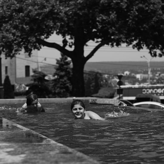 Portrait of woman with dog on swimming pool