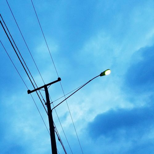 Cable Electricity  Connection Power Line  Power Supply Technology Fuel And Power Generation Electricity Pylon Low Angle View Sky Telephone Line No People Day Communication Outdoors Telephone Telecommunications Equipment Bird Nature Streetlights And Sky