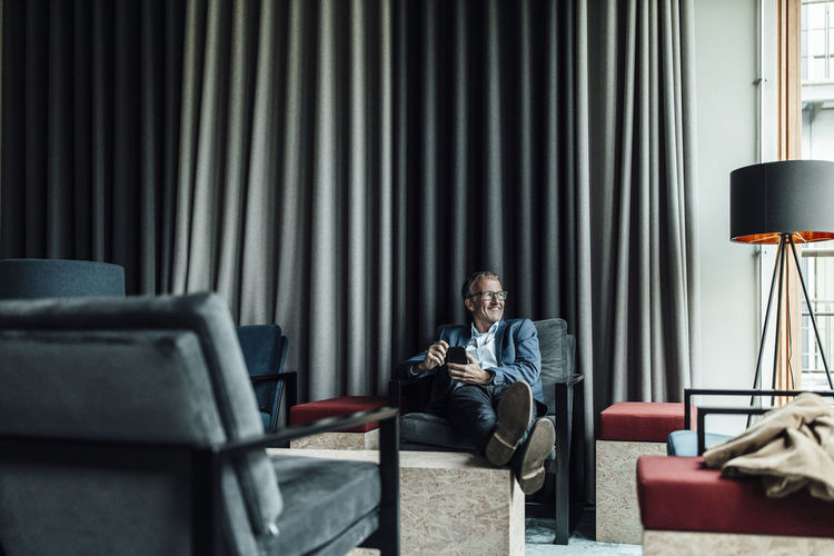 Man sitting on chair in living room
