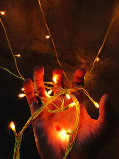 Lightning Illuminated Night Lighting Equipment Celebration Glowing Human Body Part Light Bulb Real People Human Hand Burning One Person Close-up Traditional Festival Low Angle View Flame Outdoors Christmas Lights Christmas Decoration Lantern Diwali SabarmatiRiverFront IPhoneography I7photography Sabarmati Ashram