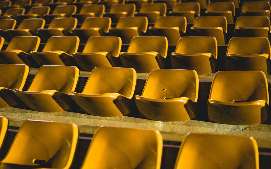 Paint The Town Yellow Arrangement Auditorium Backgrounds Chair Day Empty Full Frame In A Row Indoors  Large Group Of Objects No People Repetition Seat