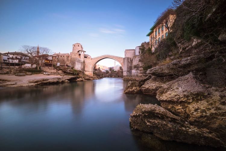 Old bridge in Mostar Bosnia And Herzegovina Mostar Travel Winter Arch Arch Bridge Arched Architecture Bridge Bridge - Man Made Structure Built Structure Connection Day History Nature No People Outdoors River Rock Rock Formation Sky Solid Travel Destinations Water