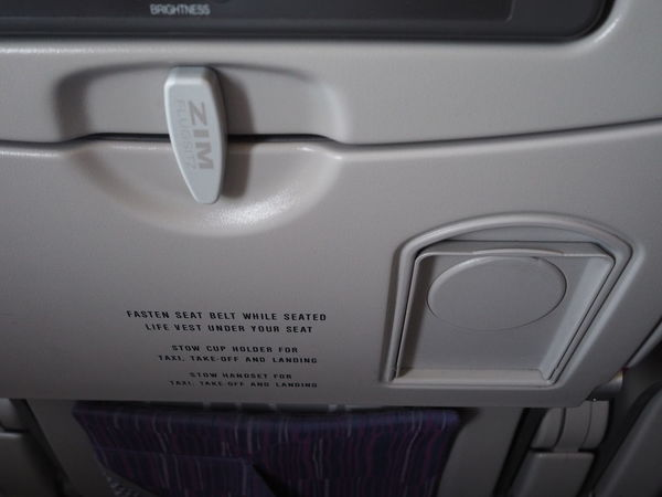 Passenger Seat Air Vehicle Airplane Airplane Wing Close-up Communication Cup Holder Folding Table Indoors  Land Vehicle Mode Of Transportation No People Number Push Button Seat Text Transportation Travel Vehicle Interior Western Script