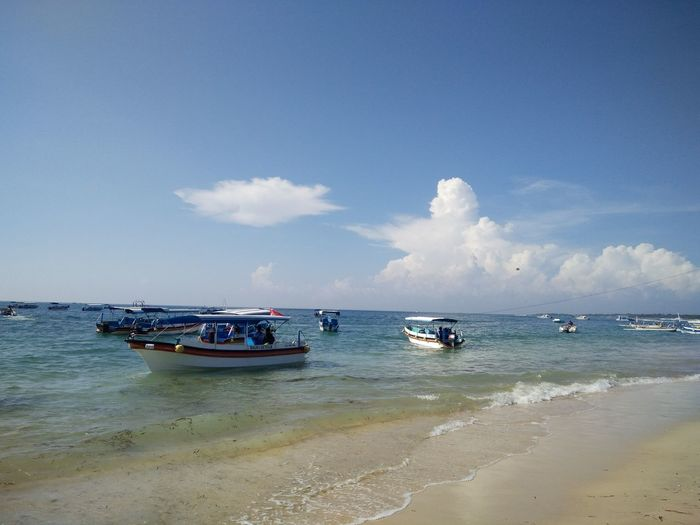 Beauty In Nature Blue Boat Cloud Cloud - Sky Day Horizon Over Water Idyllic Mode Of Transport Nature Nautical Vessel No People Outdoors Nusadua Bali, Indonesia Tanjungbenoa Remote Scenics Sea Shore Sky Tranquil Scene Tranquility Water
