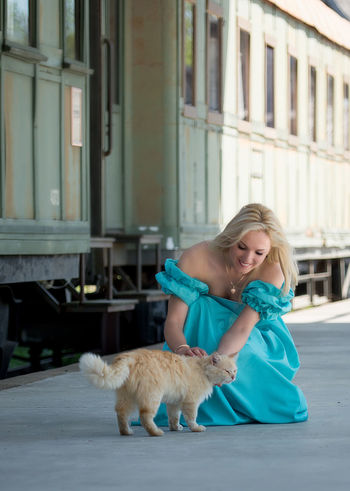 beautiful woman and cat on the platform Animal Themes Architecture Blond Hair Building Exterior Cat Day Domestic Animals Full Length Holding Long Dress Mammal Model Natural Beauty One Animal One Person Outdoors People Pets Real People Sexygirl Sexywoman Train Train Station Young Adult Young Women