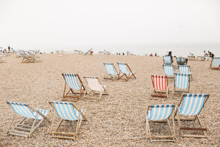 Absence Arrangement Beach Brighton Chair Day Empty Foggy Hooded Beach Chair Nature No People Outdoors Parasol Sand Seat Shore Side By Side Sky Tranquil Scene Tranquility Breathing Space Done That. Summer Exploratorium