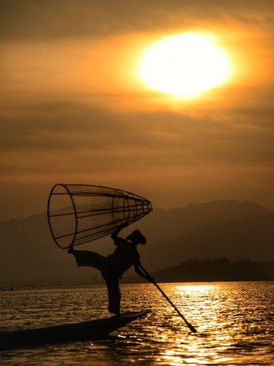 Traditional Fishermen at Inle Lake Sunset Fisherman Fishing Fishing Industry Fishing Net Silhouette Lake Nature Sun Reflection Standing Outdoors