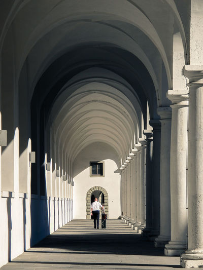 Arch Arched Architectural Column Architectural Feature Architecture Archway Colonnade Column Corridor Diminishing Perspective Dresden Full Length Germany Person Street Street Photography Streetphoto_color Streetphotography