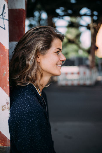 Portrait of a smiling young woman looking away