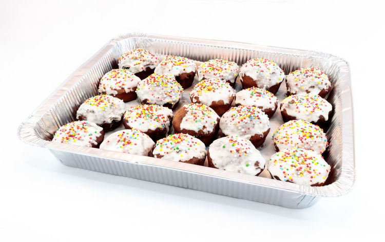 Aluminum foil tray filled with Easter cakes of homemade cakes, decorated with glaze and small round colored candies on a white background Baked Bakery Cake Candy Celebration Closeup Color Cupcake Decoration Delicious Dessert Easter Festive Food And Drink Glaze Gourmet Holiday Homemade Kulich Round Sweet Sweet Food Symbol Traditional White Background