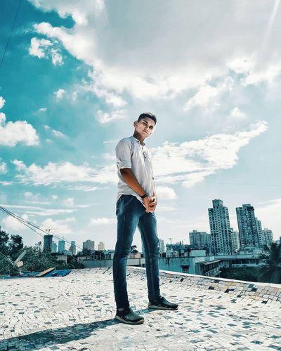 Full length of man standing on city against sky