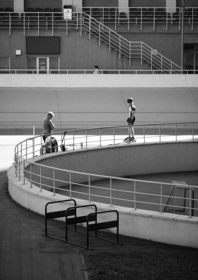 People on staircase in city