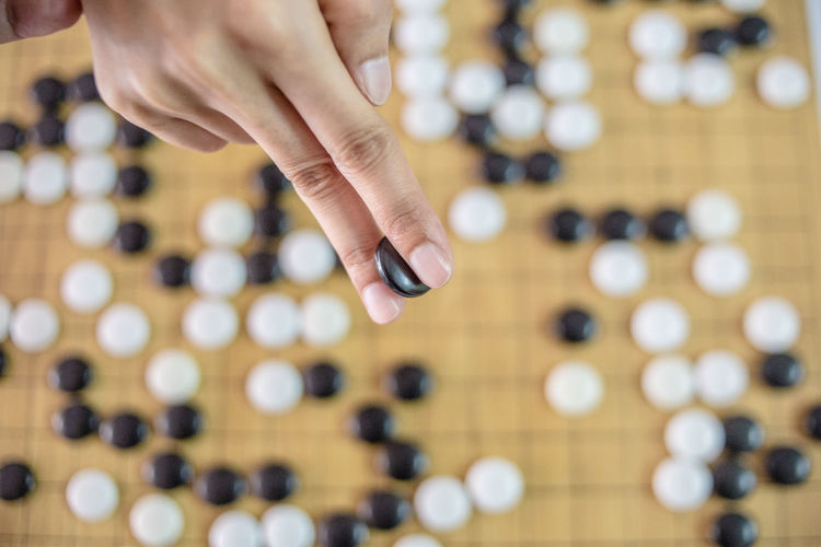 Cropped Hand Playing Japanese Checkers