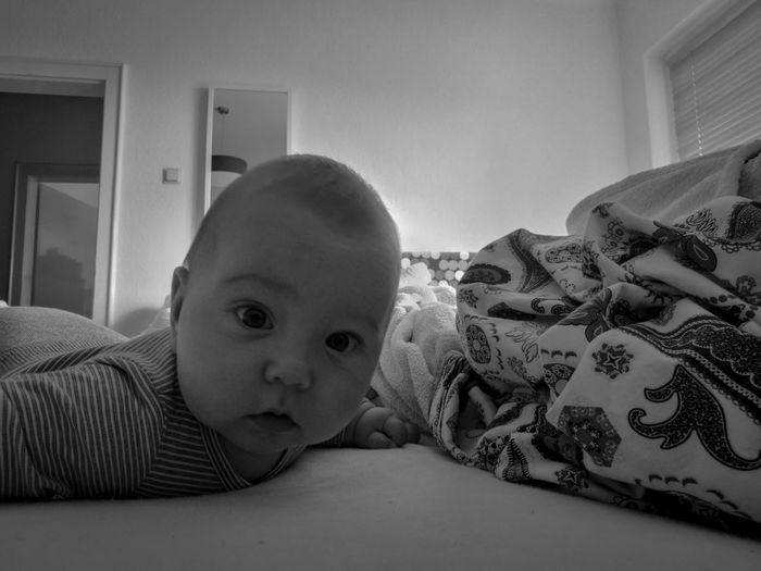 Thilo Babyboy Babylove Good Morning Portrait Photography EyeEmNewHere Son Blackandwhite MyBoy Portrait Bedroom Childhood Child Looking At Camera Home Interior Bed Baby Lying On Front At Home Lying Down Pet Bed Lying Leaning On Elbows Sleeping